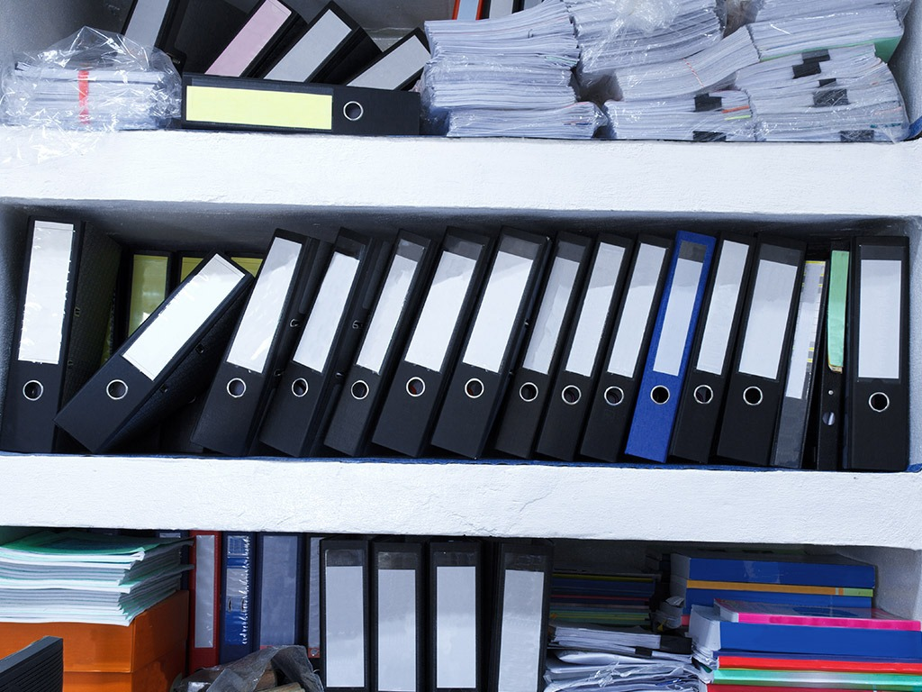cluttered documents in an office space | Store-y Self Storage