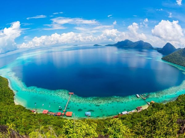 the deep blue waters of borneo under a sunny day