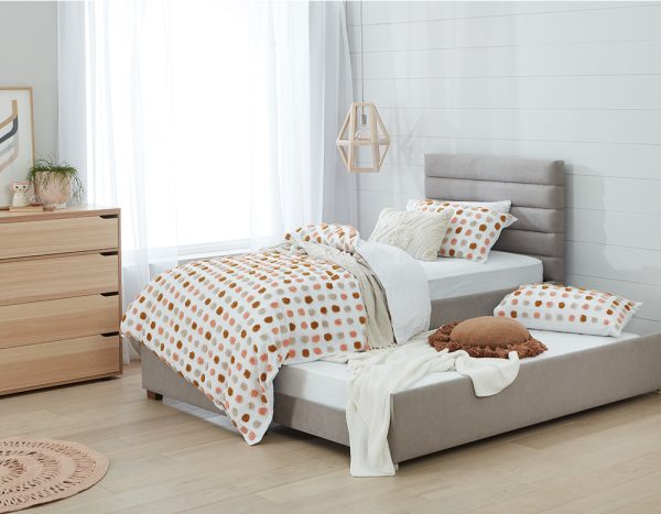 a trundle bed with a polka dot design