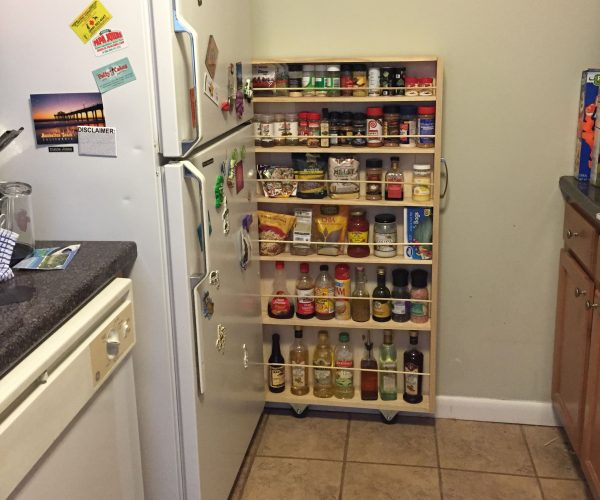 a small pantry beside the fridge