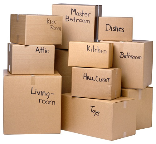 Cardboard packing boxes with labels written on them